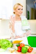 young woman in the kitchen.healthy food. dieting concept. healthy lifestyle - stock photo