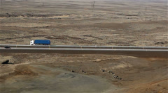 Aerial shot of semi trailer driving through desert - stock footage
