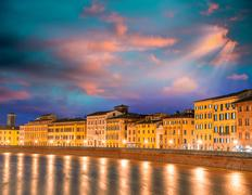 Sunset colors in lungarni. buildings along arno river Stock Photos