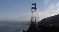 Fog rolling in over the Golden Gate Bridge in San Francisco, California Stock Footage