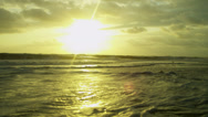 Stock Video Footage of Sunset Light Over Gentle Ocean Waves