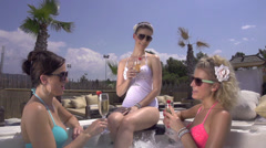 SLOW MOTION: Young women drinking champagne in jacuzzi Stock Footage