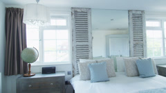 Interior view of bedroom in a stylish beachside home. No people. - stock footage