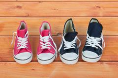 Basket ball shoes at the floor Stock Photos