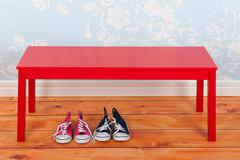 hall with blue vintage wall paper and red bench - stock photo