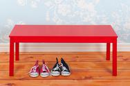 Stock Photo of hall with blue vintage wall paper and red bench