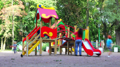 Children playing in the playground - timelapse Stock Footage