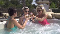 SLOW MOTION: Classy young women enjoying in jacuzzi Stock Footage