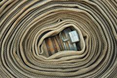 Old rolled fire hose Stock Photos