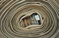 Stock Photo of old rolled fire hose