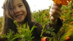 Happy Little Girl Shows Camera A Marigold Stock Footage