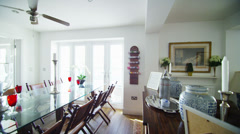 Interior view of dining and living area in a stylish beachside home. No people. Stock Footage