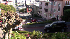 Cars navigate Lombard Street to descend Russian Hill in San Francisco Stock Footage