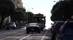 Cars and a tram travelling up the famous hilly streets of San Francisco Stock Footage