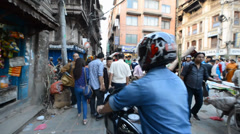 Crowd of local Nepalese people and chaotic traffic on the streets of Kathmandu Stock Footage