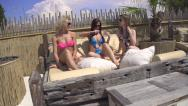 Stock Video Footage of SLOW MOTION: Girlfriends tanning on deckchair