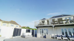 Exterior view of New England style beachside home and outdoor area. No people. Stock Footage