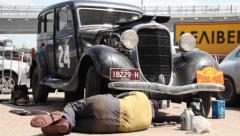 Dodge DR Special, 1934, repair man under vehicle changing oil, click for HD - stock footage