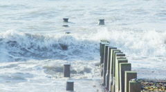 Rolling waves crash against the shoreline in slow motion. No people. Stock Footage