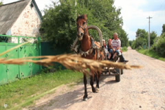 Village people ride on horse cart, summer day, poor villagers, click for HD Stock Footage