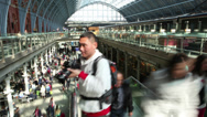 Stock Video Footage of Time lapse of travelers and commuters passing through a London railway station