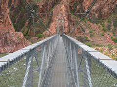 Suspension Bridge for Hikers Over the Colorado River - stock photo