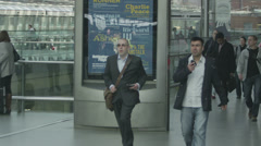 Travelers and commuters on the platform at St. Pancras railway station, London - stock footage