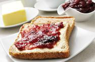 Stock Photo of coffee and toasts with butter and jam