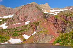red rocks over a mountain lake - stock photo