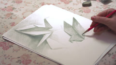 time-lapse of drawing origami crane and dove - stock footage