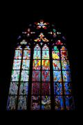 A stained-glass window in the st. vitus cathedral. praha Stock Photos
