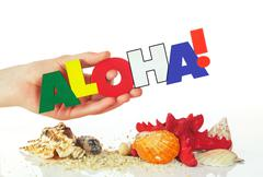 Female hand holding colorful word aloha Stock Photos