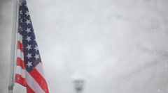 American Flag with snow long shot for titles Stock Footage