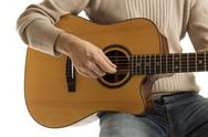 Stock Photo of musician playing an acoustic guitar