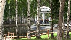Roman Rotunda (Gazebo) by a pond in a birch grove. Stock Footage