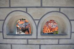 view to the city from the archway of the tower - stock photo