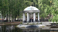 Stock Video Footage of Roman Rotunda (Gazebo) by a pond in a birch grove.