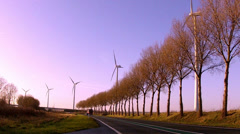 Wind turbines along the road. Time lapse. Stock Footage
