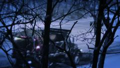 Night Snow Plow | truck plows / salts streets during winter storm Stock Footage