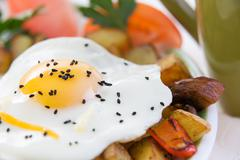 wholesome meal of fried egg and vegetables - stock photo