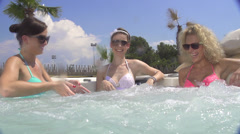SLOW MOTION: Young woman having fun in jacuzzi Stock Footage