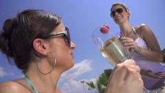 SLOW MOTION: Cheerful young woman drinking champagne Stock Footage