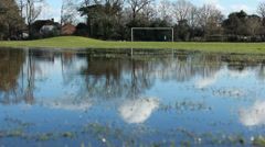 Reflections in a flooded football field Stock Footage
