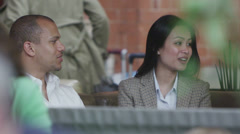 Cheerful group of friends chatting together at a restaurant Stock Footage