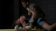 Mixed Martial Arts - Tattooed Fighters Grappling - stock footage