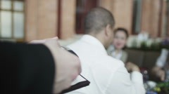 Waiter in a restaurant brings a card reader to the table for the bill to be paid - stock footage