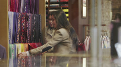 2 attractive female friends shopping together in a man's clothing store. Stock Footage