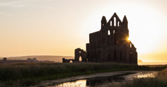 4K sunset time lapse of Whitby Abbey in North Yorkshire, UK Stock Footage