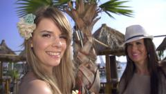 SLOW MOTION: Smiling young women in a bar Stock Footage