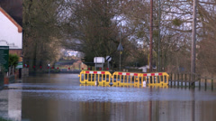 Flooded road in Upton Upon Severn - stock footage